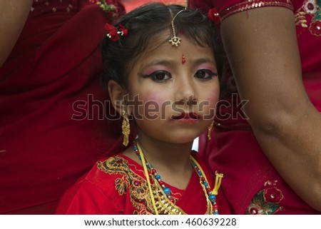 Kathmandu, Nepal-September 6, 2013: A young girl celebrates Teej with her mother