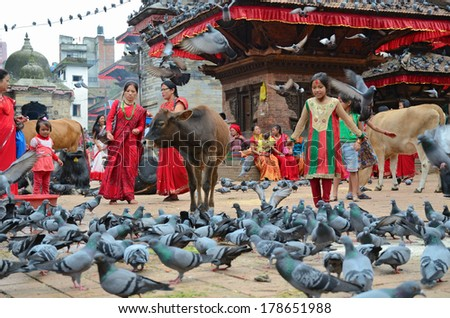 Kathmandu, Nepal - September 18, 2012: Hindu women in traditional red sari celebrating the Haritalika Teej festival, Durbar square, Kathmandu, Nepal - stock photo