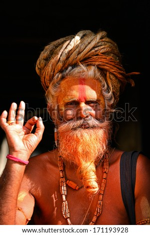 KATHMANDU - OCT 8: Sadhu at Pashupatinath in Kathmandu. Sadhus are holy men who have chosen to live an ascetic life and focus on the spiritual practice of Hinduism. On Oct 8, 2013 in Kathmandu, Nepal  - stock photo