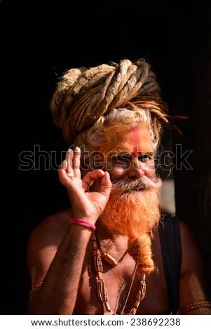 KATHMANDU - OCT 8: Sadhu at Pashupatinath in Kathmandu. Sadhus are holy men who have chosen to live an ascetic life and focus on the spiritual practice of Hinduism. On Oct 8, 2013 in Kathmandu, Nepal  - stock photo