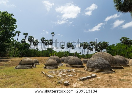 Kathurogoda Ancient Vihara, Jaffna district, Sri Lanka: a cluster of several little stone dagobas in a mysterious ancient buddhist site in the middle of the hindu - tamil region. - stock photo