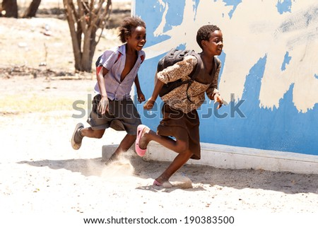 KATIMA MULILO, NAMIBIA - OCTOBER 16 2013: Kids playing during a year of drought in the North Eastern town of Katima Mulilo in Namibia, Africa - stock photo
