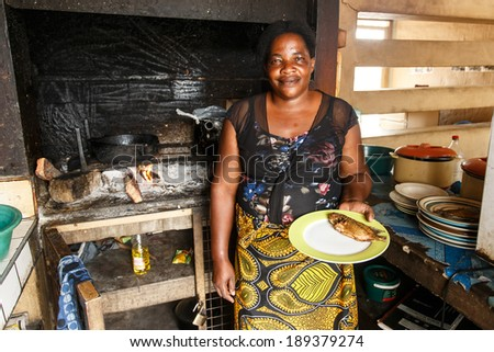 KATIMA MULILO, NAMIBIA - OCTOBER 16 2013: Woman cooks authentic fish dish in food market during a year of drought in the North Eastern town of Katima Mulilo in Namibia, Africa - stock photo