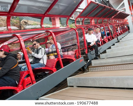 KATOOMBA, AUSTRALIA - FEB 05, 2014: Passengers sit in the scenic railway train in Blue Mountains, New South Wales, Australia - stock photo