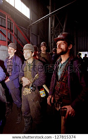 KATOWICE - MAY 16:  Coal miners from the Katowice  II (KWK) coal mine await the elevator that will take them 1800 feet below the earth in Katowice, Poland, on May 16, 2001.