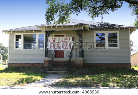 Katrina flood damaged house with rebuild sign on door - stock photo