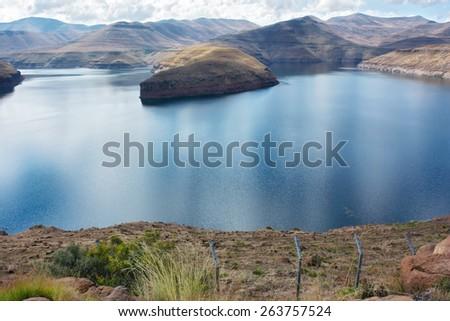 Katse Dam - panoramic view. Shot in Lesotho. - stock photo