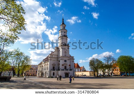 KAUNAS, LITHUANIA - APRIL 30, 2015 : Front view of Town Hall building in town hall square of Kaunas old town, Lithuania, built in 16th century, on cloudy blue sky background. - stock photo