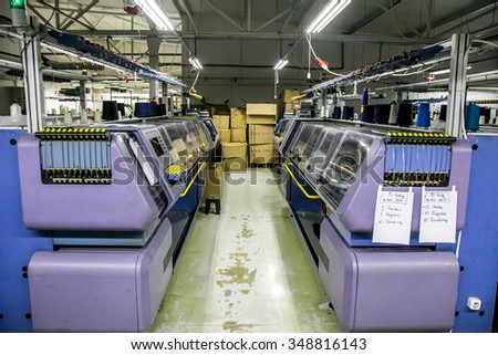 KAUNAS, LITHUANIA - DECEMBER 8, 2015: Automatic sewing machine