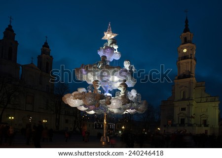 Kaunas, Lithuania - December 27, 2014: Main Christmas tree of Kaunas stands in City Hall Square on December 27, 2014 in Kaunas, Lithuania. Created from plastic cups by designer Jolanta Smidaitiene.