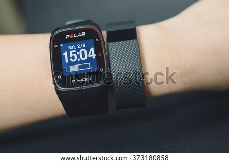 KAUNAS, LITHUANIA - FEBRYARY 06, 2016: Activity tracker (Fitbit Charge HR) and sport watch (Polar M400) on girl hand - stock photo
