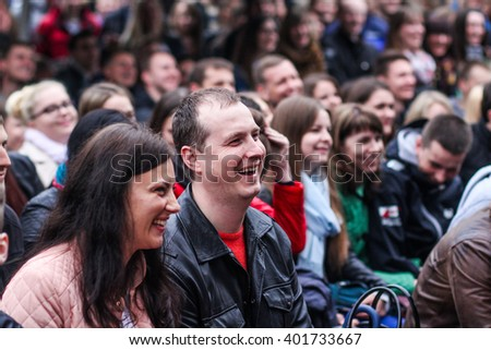 "KAUNAS, LITHUANIA - JUNE 06, 2015: Free public entry event - ""Kitokie pasikalbejimai"". Happy people listening to talk show. Happy people laugh. People group smile"