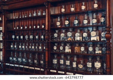 apothecary furniture collection. kaunas lithuania may 12 2017 shelf of vials with retro drugs in apothecary furniture collection
