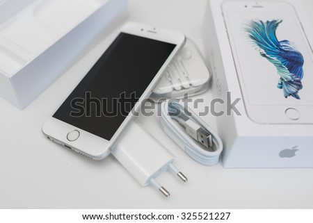 KAUNAS, LITHUANIA - OCTOBER 09, 2015: Unboxing new Apple iPhone 6S. Isolated on white.