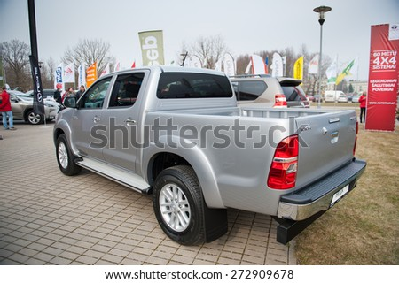 KAUNAS - MAR 26: Toyota Hilux on display on Mar. 26, 2015 in Kaunas, Lithuania. The Toyota Hilux is a series of compact pickup trucks produced and marketed by the Japanese manufacturer Toyota. - stock photo