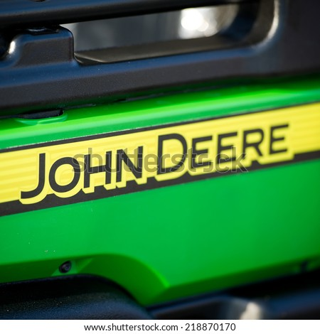 KAUNAS-SEP 19: John Deere Logo on Sep. 19, 2014 in Kaunas, Lithuania. Deere & Company-John Deere is an American corporation. Manufactures agricultural, construction, forestry machinery, diesel engines - stock photo