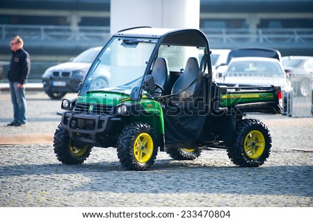 KAUNAS-SEP 19: John Deere XUV 825i Power Steering on Sep. 19, 2014 in Kaunas, Lithuania. The John Deere Gator is a family of small all-terrain utility vehicles produced by the John Deere Corporation. - stock photo