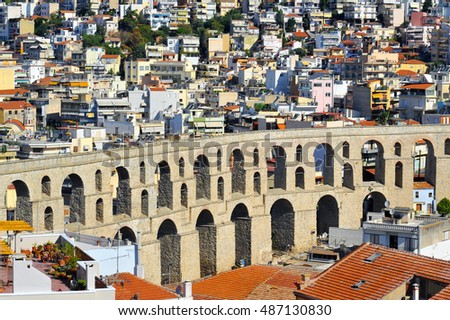 KAVALA, GREECE - AUGUST 15: Cityscape with medieval aqueduct Kamares, landmark in the city in East Macedonia, on August 15, 2016 in Kavala, Greece