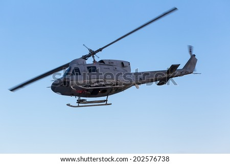 KAVALA, GREECE- JUNE 21, 2014: Agusta Bell helicopter in flight during the Kavala Airshow 2014, in Kavala, Greece. - stock photo