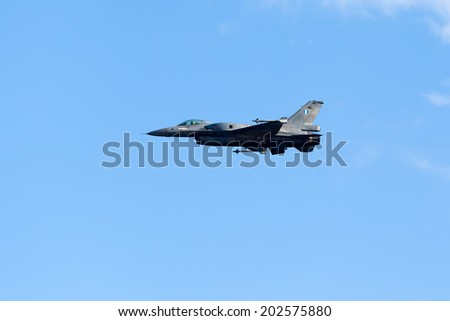 KAVALA, GREECE- JUNE 21, 2014: HAF F-16 flying in the sky during the Kavala Airshow 2014, in Kavala, Greece.