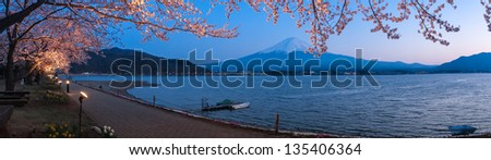 KAWAGUCHI, JAPAN - APR 13: Cherry blossom festival at lake Kawaguchi, April 13, 2013 in Japan. Viewing cherry blossom is a traditional Japanese custom. Kawaguchi is one of the best place to enjoy it. - stock photo