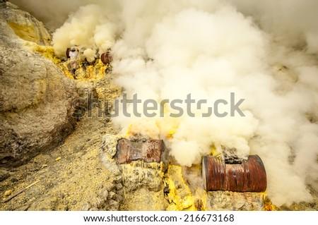 Kawah Ijen, Indonesia - April 24,2010 :  Workers extracting sulfur inside Ijen crater  in Ijen Volcano, Indonesia.  - stock photo