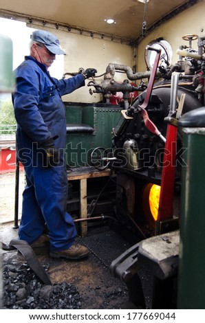 KAWAKAWA,NZ - JAN 11:Train driver prepares Gabriel steam engine on Jan 11 2014.Built in 1927 it's a fine example of a working steam engine and is the only one in her class left in the world.