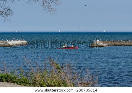 Kayak and sailboats on Lake Ontario - stock photo