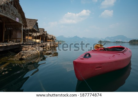Kayak at Rachapapha dam. Khao Sok National Park. Thailand. - stock photo