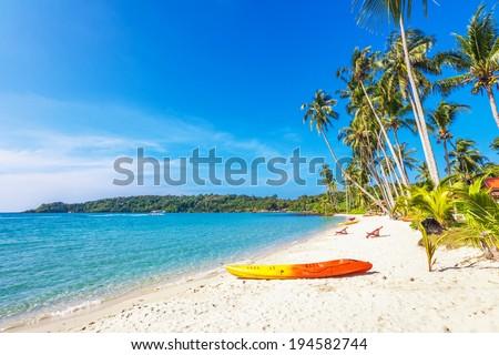 Kayak at the tropical beach  - stock photo