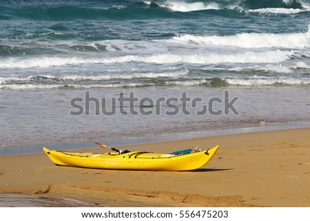 kayak is on a sandy beach, the Mediterranean Sea,