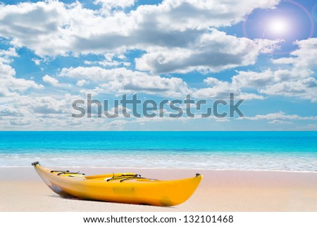 kayak on a pink paradise beach on a sunny day in Sardinia - stock photo