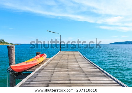 Kayak on Wooden Pier with Blue sea and sky at Ko lam ya National park, Thailand - stock photo