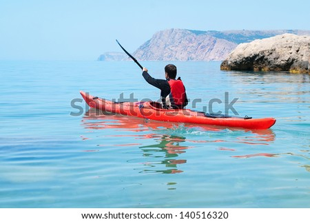 Kayak. People kayaking in the ocean. Active people. Sport and recreation - stock photo
