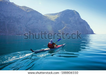 Kayak. People kayaking in the sea with calm blue water.  - stock photo