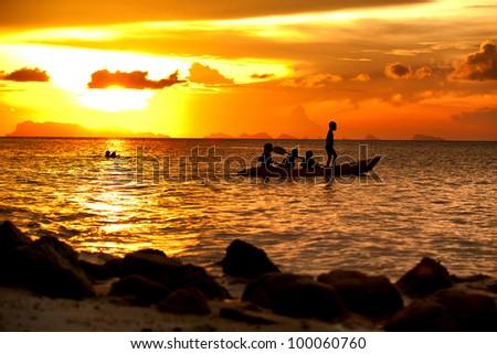 Kayak relax on the beach between sunset. - stock photo