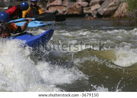 kayak surfing wave