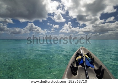 Kayak with snorkeling gear on tropical lagoon.