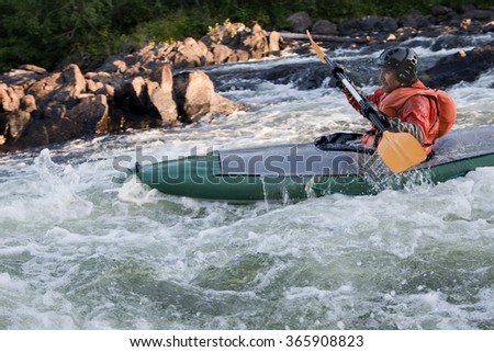 Kayaker in whitewater