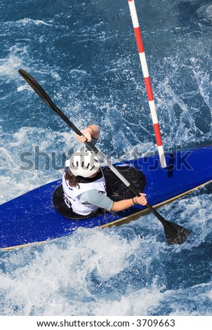 kayaker manoeuvring in extreme whitewater - stock photo