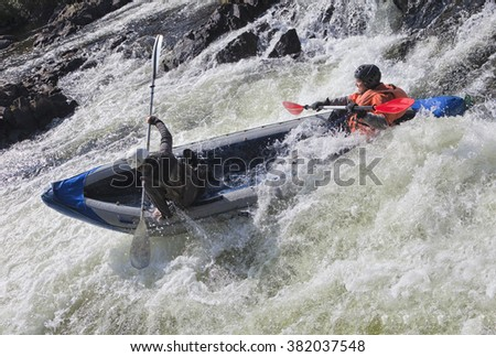 Kayakers in whitewater