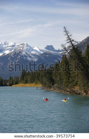 Kayakers on the Bow River,  Canadian Rockies, Banff, Alberta, Canada