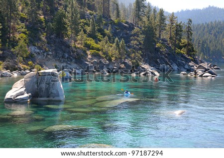 Kayaking along east shore of Lake Tahoe in California - stock photo