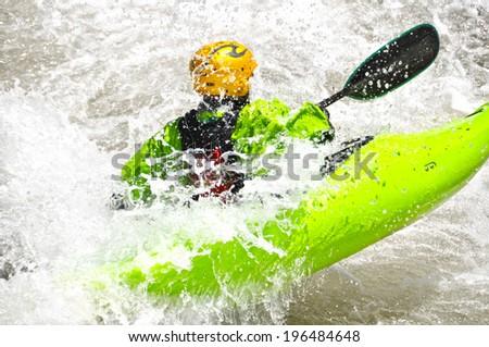 Kayaking as extreme and fun sport - stock photo