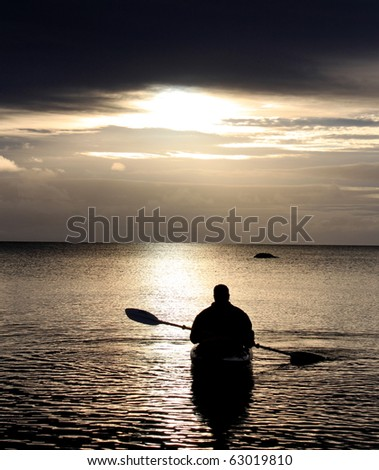 Kayaking in the Sunset - stock photo