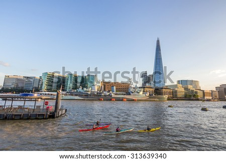 Kayaking in the Thames River next the the Shard in London, UK - stock photo