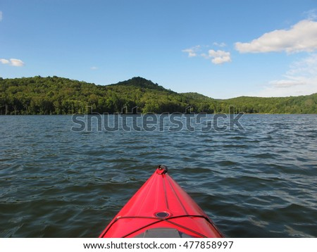 Kayaking on a scenic lake in the summer time.