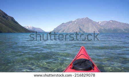 Kayaking on scenic Kathleen Lake in Yukon Territories Canada on a beautiful summer day. - stock photo
