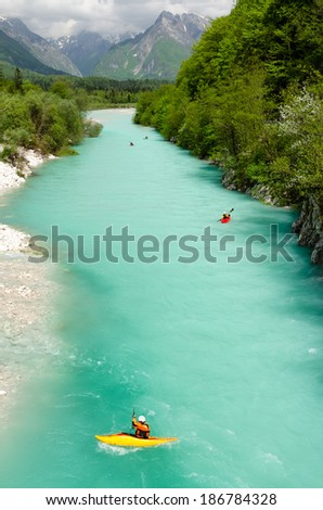 Kayaking on the beautiful turquoise Soca river in the Triglav National Park in Slovenia.