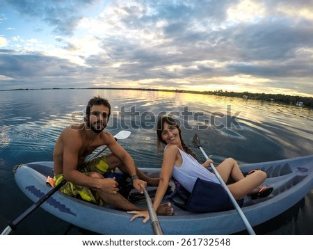 Kayaking Selfie Pole young couple doing sports at sunset. Mexico, central America Traveling. - stock photo